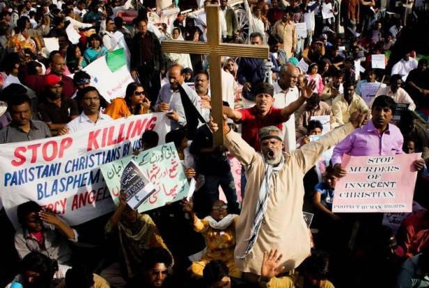 Nov. 9, 2014 - Lahore, Punjab, Pakistan - Pakistani Christians community take a part during a rally to condemn the killing of a Christian couple, in Lahore. A Christian bonded labourer and his pregnant wife were killed November 4 for allegedly Police in Pakistan said they have arrested as many as 45 Muslims in connection with the killing of the Christian couple for allegedly desecrating pages of the Quran. Under Pakistan's harsh blasphemy laws, anyone convicted of insulting Islam or the Prophet Muhammad can be sentenced to death. However, the laws are often misused to settle personal scores and target minorities. Pakistan: proteste a Lahore per la coppia cristiana bruciata viva ZumaPressLaPresse  -- Only italy